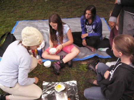 Ontario Camp Cherith girls frying egg on can