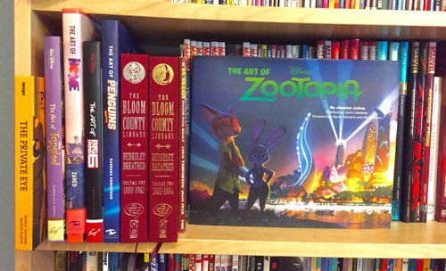 "Bookshelf with movie ""Art Of"" books"