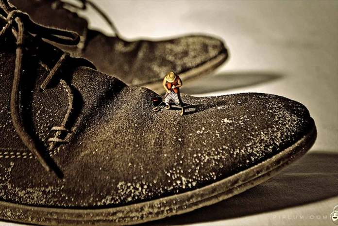 Man-cleaning-shoes-Surreal-photography