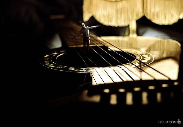 man-walking-on-a-guitar-string