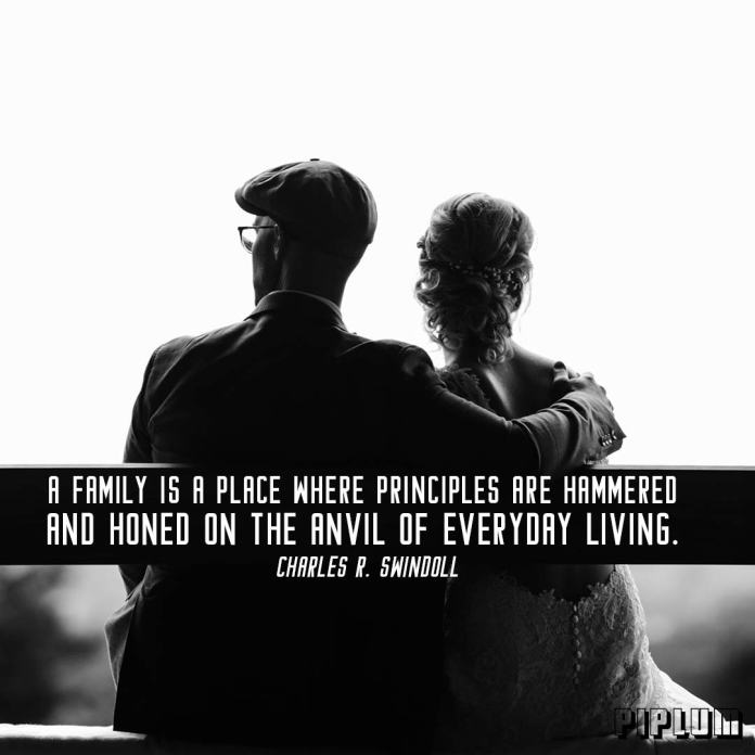 Family Quote. Married middle age couple sitting on a bench
