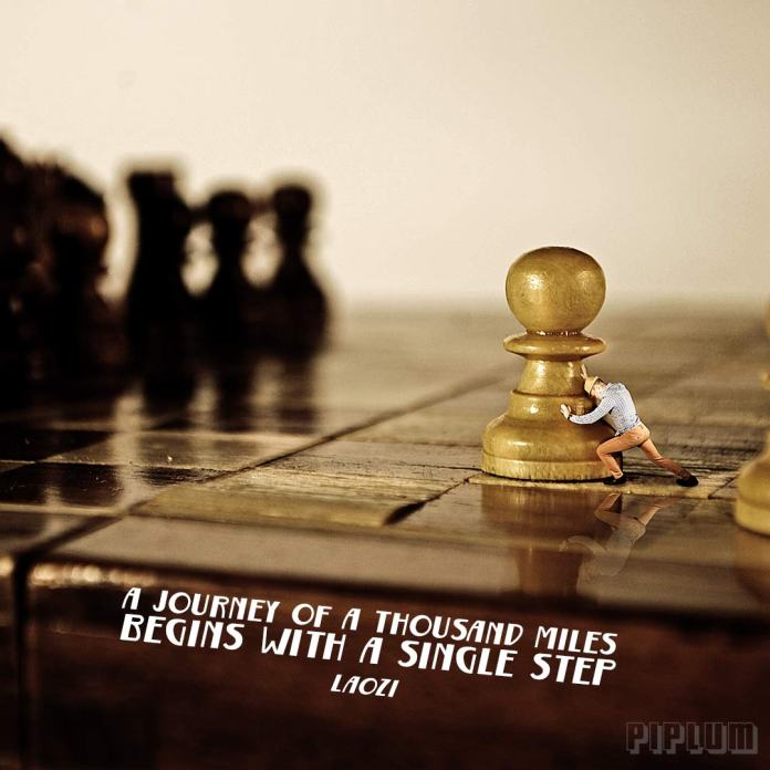 Inspirational quote. Miniature man pushing chess figure towards is goal. Surreal photography. Photo manipulation.