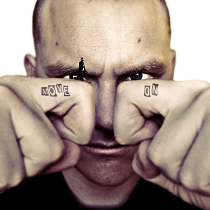 Man-face-with-bended-fingers-in-front-Text-tatoos-on-each-surreal-photography