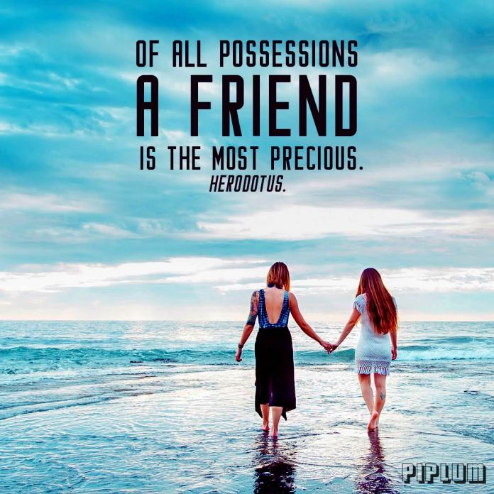 Friendship quote. 2 girlfriends walking on blue and shinny beach and holding their hands.