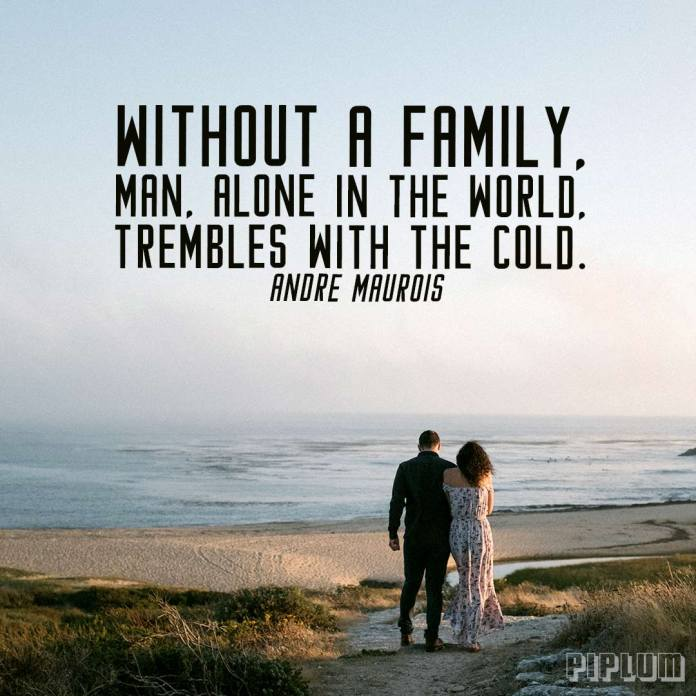 Family quote. Couple walking by the ocean.