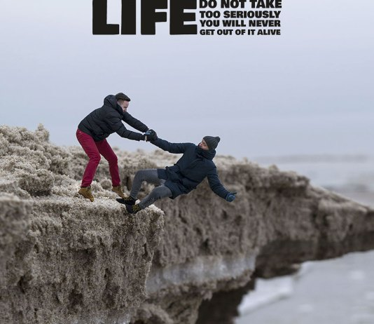 2 guys on the edge of the rock risking for their lives for a photo shoot.