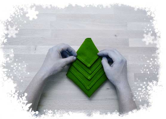 Christmas-tree-folding-tutorial-Fold-the-upper-layer-to-the-top-to-form-a-peak-Step-5.