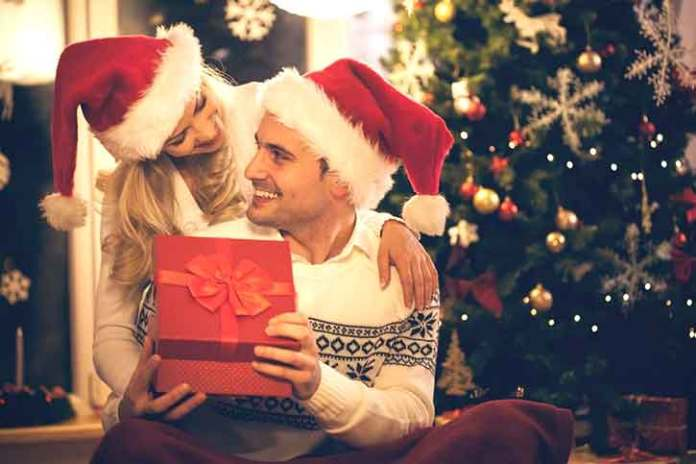 Christmas-couples-photography-Moment-of-giving-and-getting-gifts