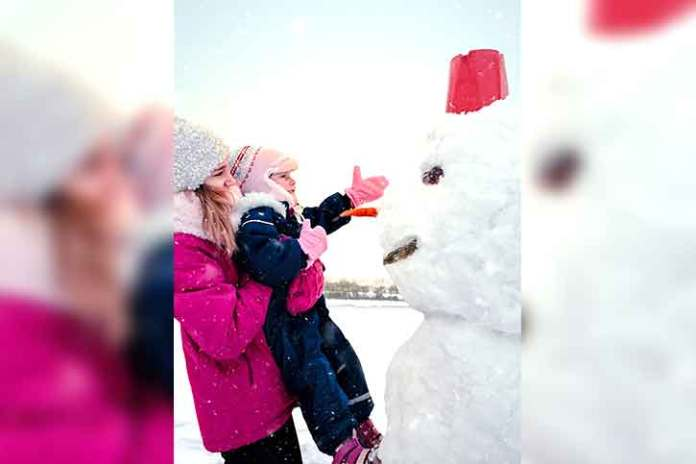 christmas-photo-with-snowman-touching-kid