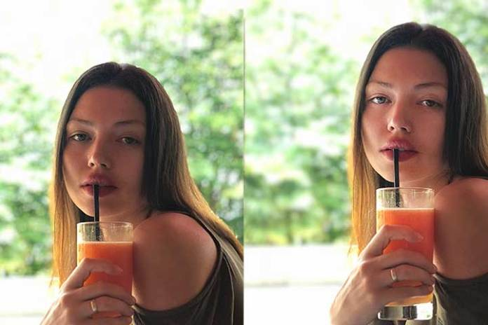 rule-of-thirds-selfie-composition-girl-drinking-carrot-juice-with-a-straw