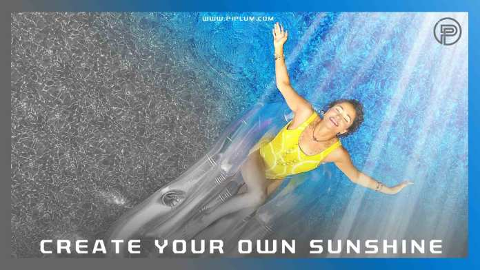 motivational-quote-Create-your-own-sunshine-uplifting-girl-floating-light-rays-ocean-pool