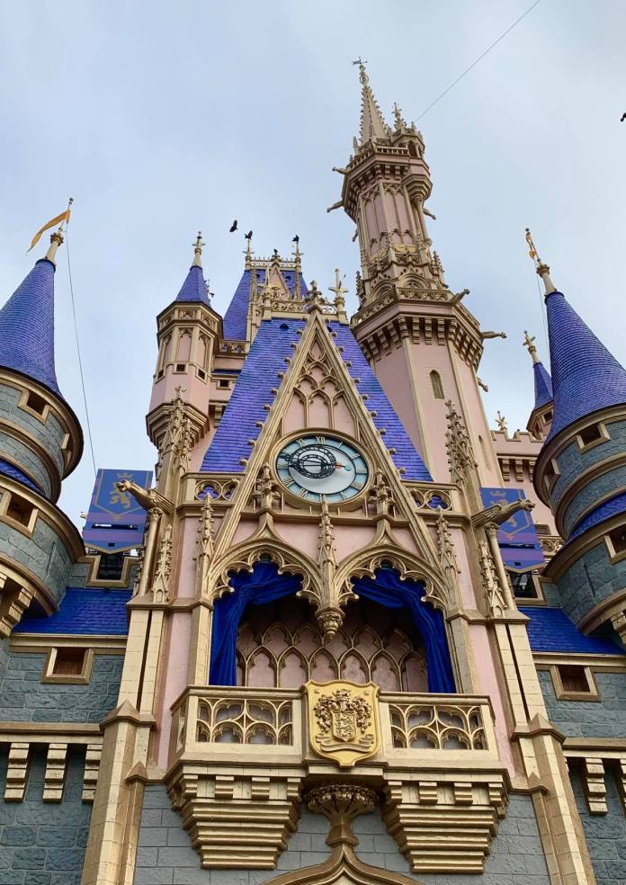 Close up picture of the new pink and blue paint job on cinderella castle in Walt Disney World
