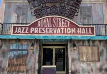 Building made to look like it belongs in New Orleans. The worlds Tribute STore, Royal Street Jazz Preservation Hall are on the marquis