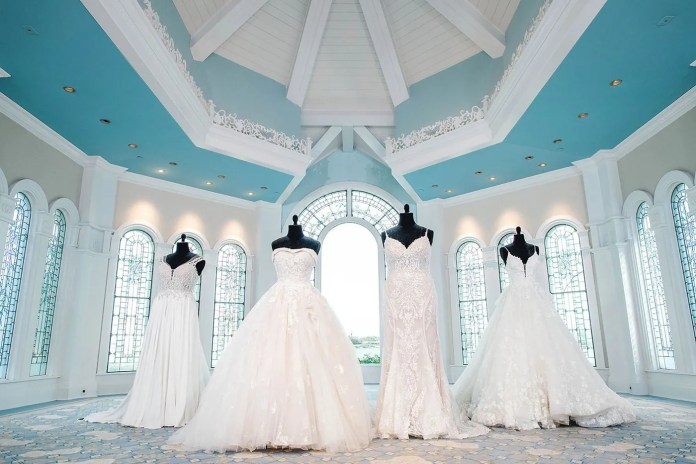 Four wedding gowns, each one inspired by a different Disney princess- Jasmine, Belle, Tiana, and Snow White