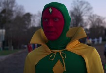 Vision dressed in his classic comic outfit. It's a green hooded body suit, with yellow diamond on the chest and yellow cape.