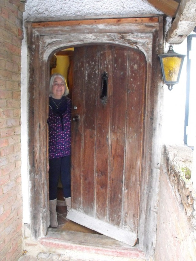 Tudor arched carved front door. For a house of its age, the front door is not where it would be expected to be and may have been an entrance to a screens passage or non residential use.
