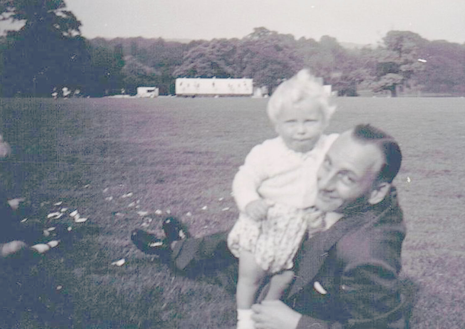 Bernard Lake, Tom and Miriam's son, holding his son Stephen.