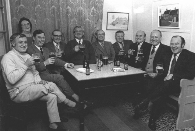 1972  Mrs Cook and her regulars around the only table in the front bar. L-R: Bill Sykes, John Dawson, May Cook, George Trussell, Bill Brown, Dick Owens, Doug Walker, Jock Foster, Bill Saunders, Jack Soulsby. It was a very traditional pub; if a non-regular entered all conversation would stop.