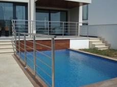 Construcción de un chalet adosado con piscina en Aucanada