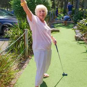 Senior Lady Playing Mini Golf at Pittwater Golf Centre