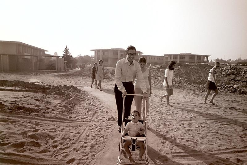 Harvey Botwin Pushes Son Alan in Stroller Along Dirt Walkway, September 26, 1968