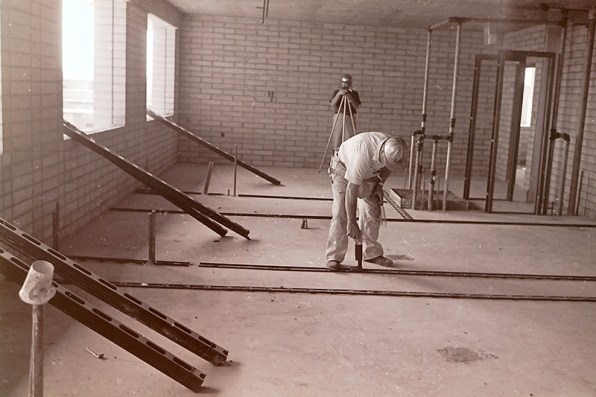 Construction Workers in the Interior of Holden Hall, undated