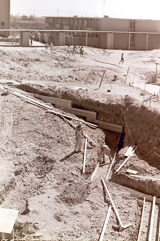Construction Footing for Avery Hall with Dirt of the Future Mounds, and Holden Hall in Background, September 26, 1968
