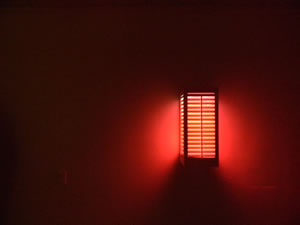 Red Icon (2010); Medium-density fiberboard, fluorescent; light, red and violet gel; 12x12x36 inches