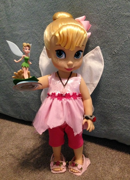 Tinker Bell with toy.