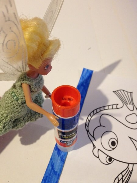 Tinkerbell doll with glue.