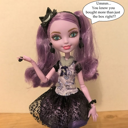 Kitty Cheshire Doll With Speech Bubble: You know you bought more than just the box, right?
