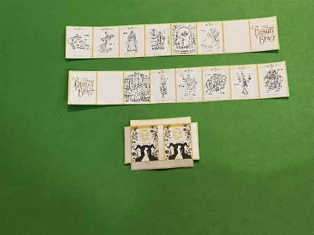 Cut book cover and strips of pages from printable.