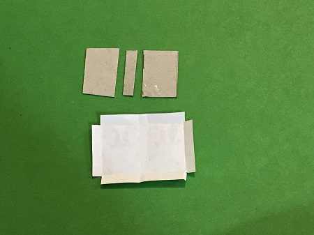 Glue paperboard to book cover.