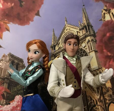 Classic Anna And Hans Dolls Dancing With Clock Background
