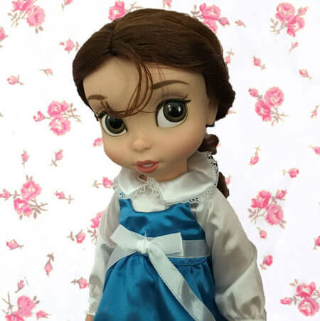 Disney Animator Belle Doll With Pink Flower Background
