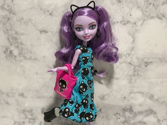 Image of Kitty Cheshire wearing blue Barbie dress.