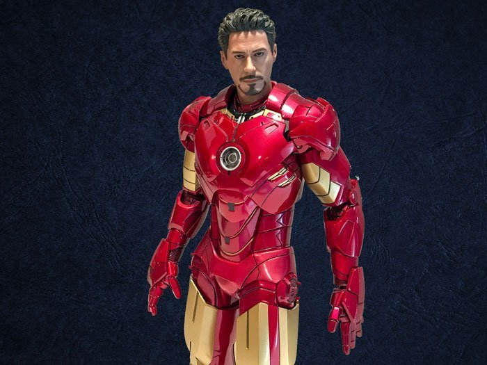 Hot Toys Iron Man Mark IV with navy background.