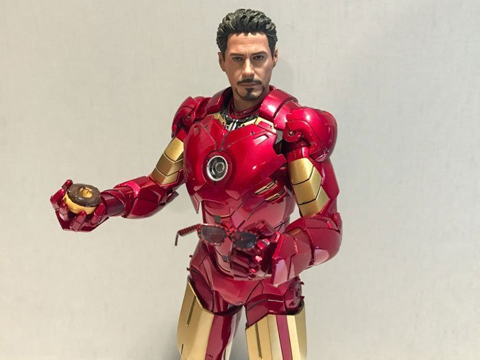 Tony Stark figure holding donut and glasses.