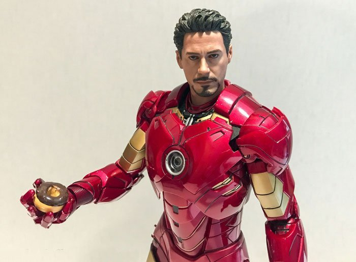 Hot Toys Iron Man Mark IV holding a donut.