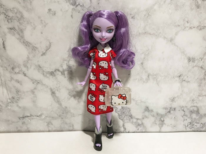 Kitty Cheshire looks lovely in the red Hello Kitty dress.