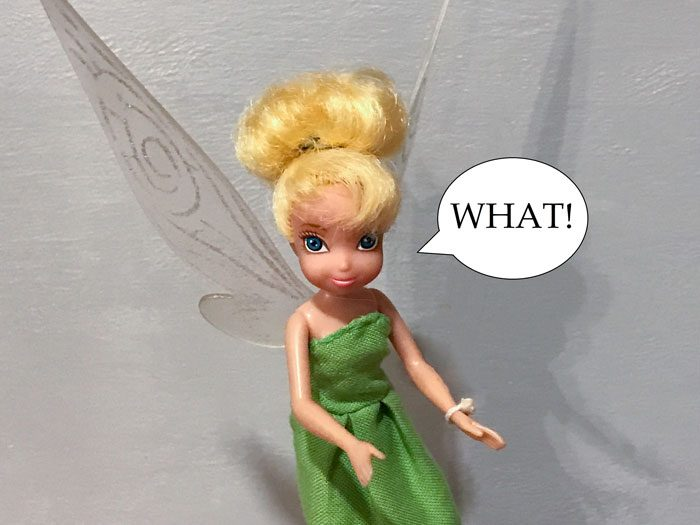 Image of Tinkerbell doll with speech bubble: What!