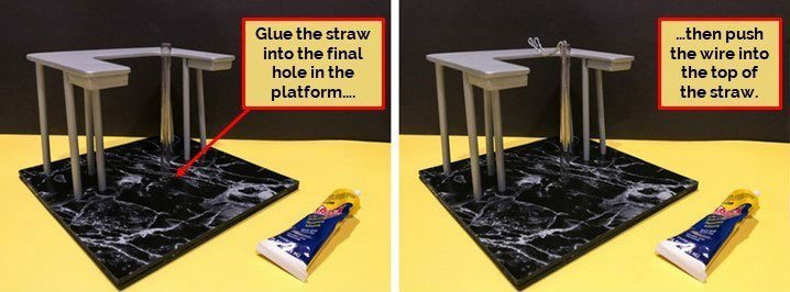 Glue the straw to the platform and insert the wire.