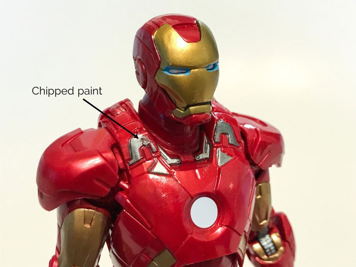 Chipped paint on Iron Man's shoulder.