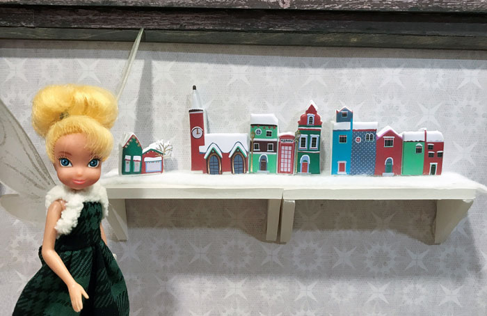 Tinkerbell with miniature Christmas villages.