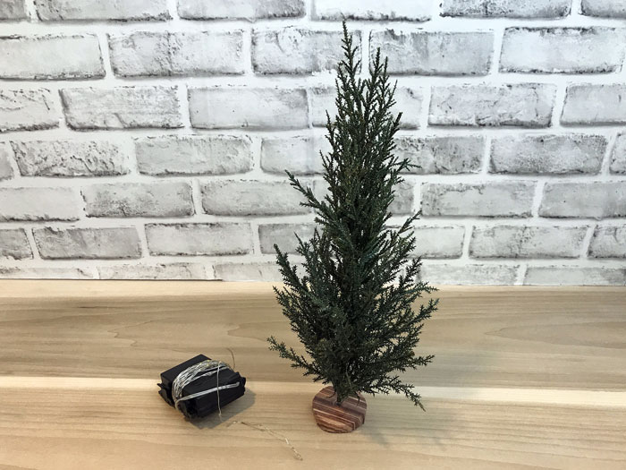 Use fairy lights for your miniature Christmas trees.