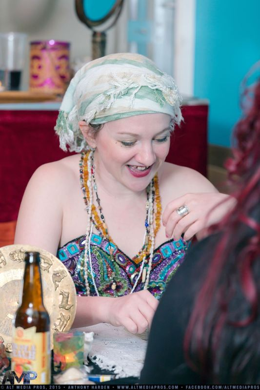 Amber Pixie reading tarot at an event, image credit AltMedia