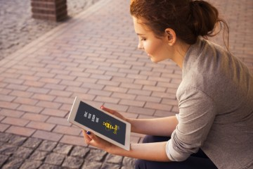 Woman with Apple iPad Free PSD Mockup