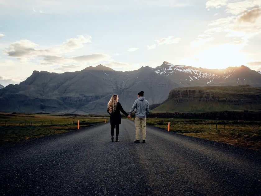 couple walking on a long road