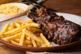 fries and steak on white ceramic plate