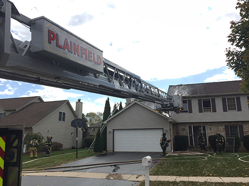 photo of a house and ladder, after a fire